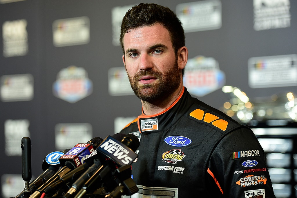 Corey LaJoie, NASCAR driver of the #32 RagingBull.com Ford, speaks with the media during the NASCAR Cup Series 62nd Annual Daytona 500 Media Day at Daytona International Speedway on February 12, 2020 in Daytona Beach, Florida.