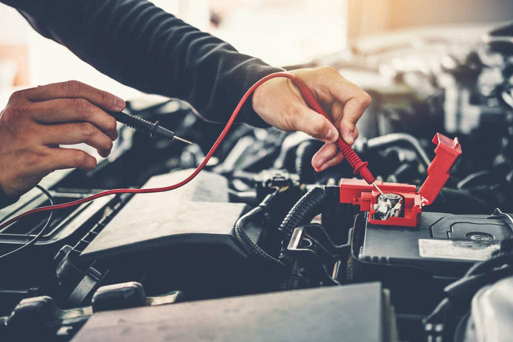 Mechanic working on a car battery