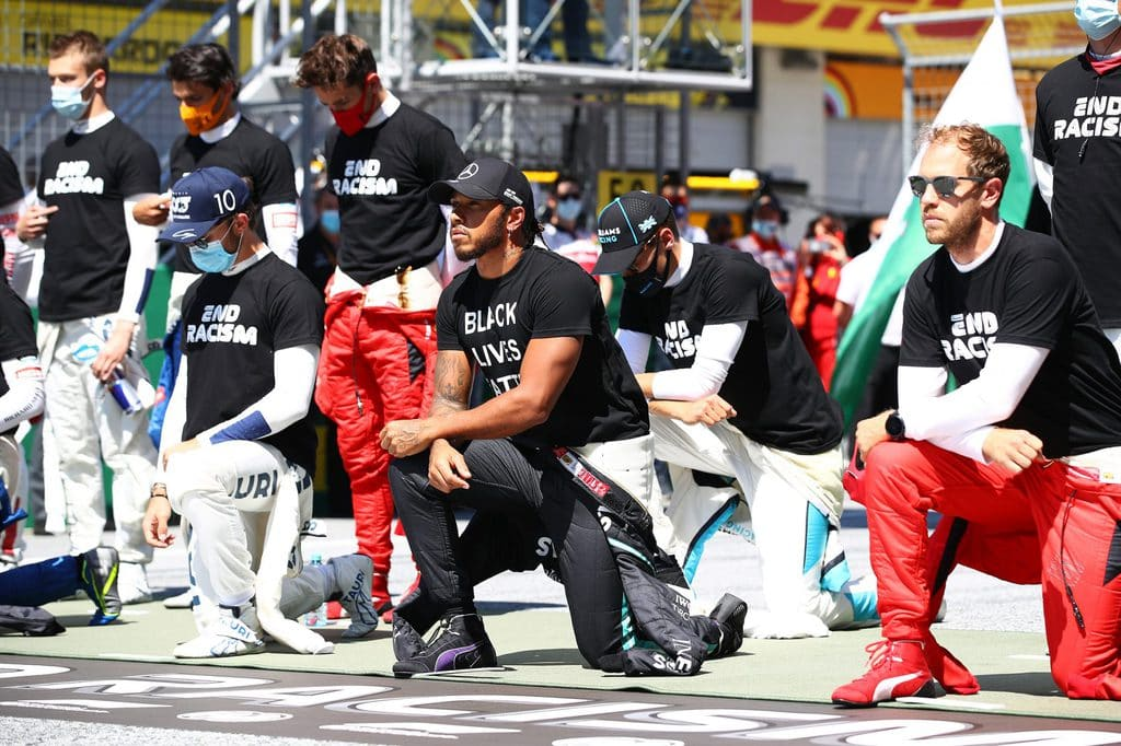 Lewis Hamilton being joined by other drivers in taking the knee ahead of a race.