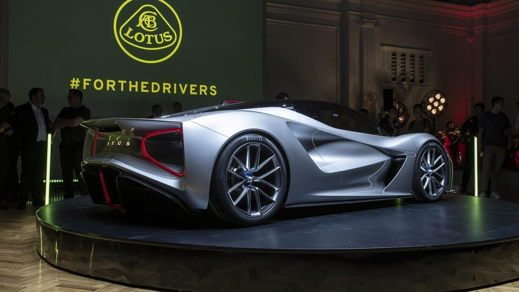Lotus presenting the Evija during an automobile convention.